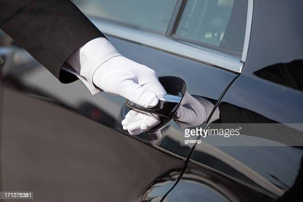 chauffeur opening / closing luxury car door - stereotypically upper class stock pictures, royalty-free photos & images