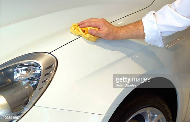 Chauffeur polishing car
