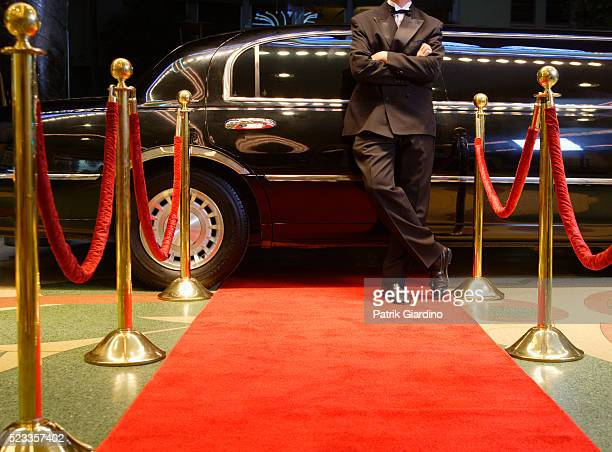 chauffeur waiting for star at red carpet event - red carpet event stock pictures, royalty-free photos & images