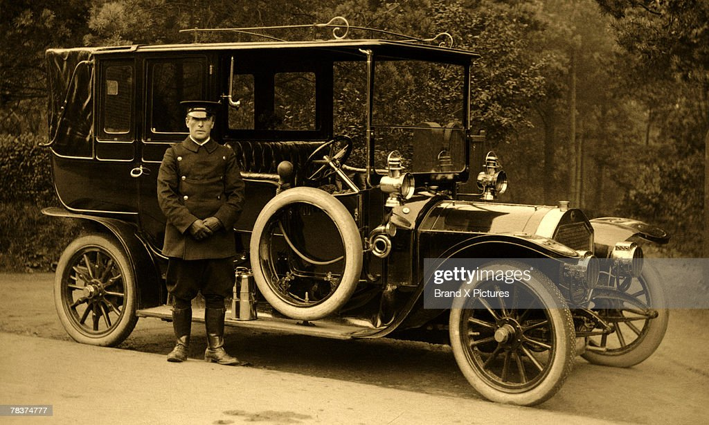 Chauffeur With Oldfashioned Vehicle Stock Photo | Getty Images