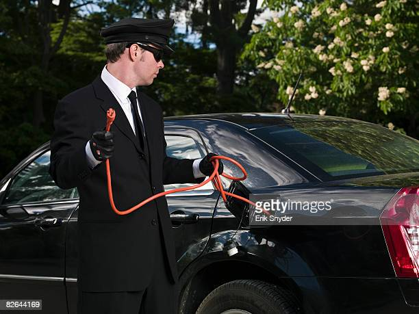 Chauffeur with  power cord from rechargable limo.
