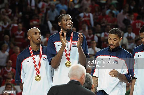 Chauncey Billups, Kevin Durant and Derrick Rose of the USA Senior Men's National Team celebrate following the game against Turkey during the 2010...