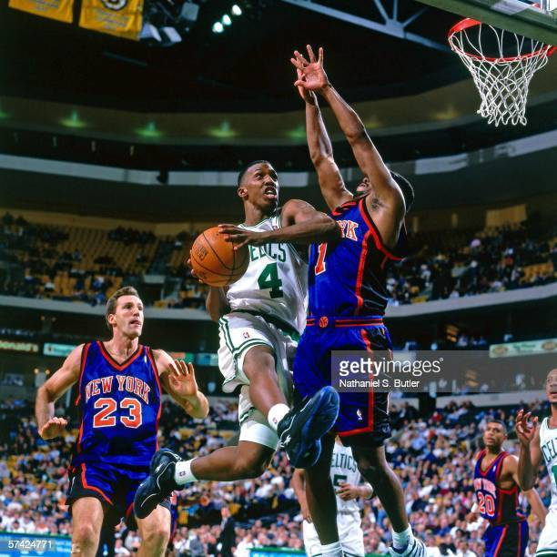 Chauncey Billups of the Boston Celtics takes the ball to the basket against Charlie Ward and Chris Dudley of the New York Knicks during a game at the...