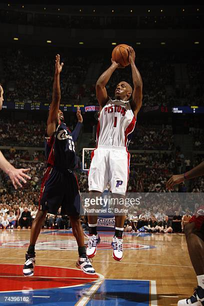 Chauncey Billups of the Cleveland Cavaliers shoots a jump shot against Larry Hughes of the Detroit Pistons in Game Five of the Eastern Conference...