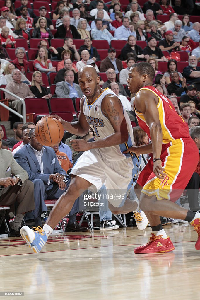 Chauncey Billups #1 of the Denver Nuggets drives the ball past Kyle Lowry #7 of the Houston Rockets on February 14, 2011 at the Toyota Center in Houston, Texas.