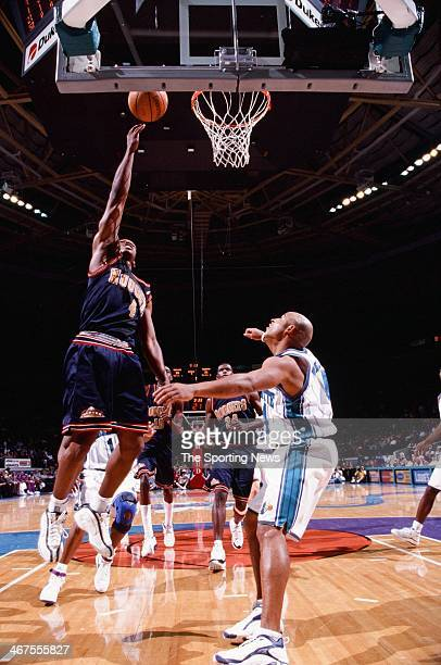 Chauncey Billups of the Denver Nuggets lays up a shot during the game against the Charlotte Hornets on December 10 1999 at Charlotte Coliseum in...