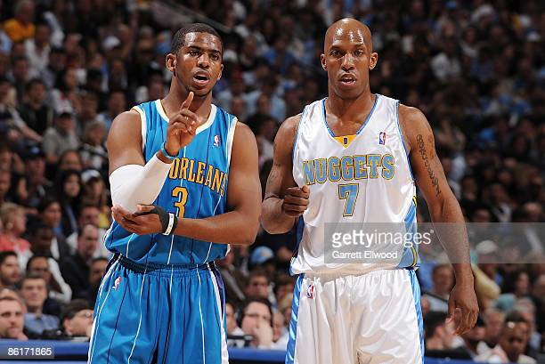 Chauncey Billups of the Denver Nuggets stands with Chris Paul of the New Orleans Hornets during Game Two of the Western Conference Quarterfinals...