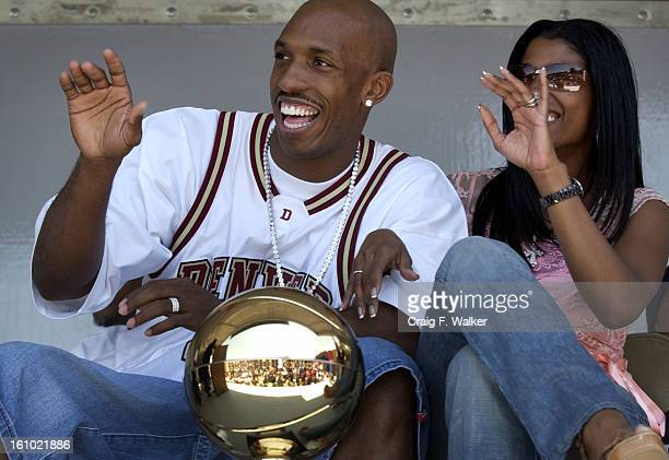 DENVER CO JULY 01 2004 Chauncey Billups of the Detroit Pistons and his wife Piper <cq>wave to the crowd while being honored at the Hiawatha Davis JR...