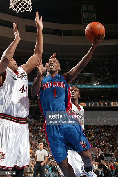 Chauncey Billups of the Detroit Pistons attempts a shot against Derrick Coleman of the Philadelphia 76ers during NBA action November 26 2003 at the...