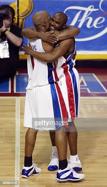Chauncey Billups of the Detroit Pistons celebrates with teammate Mike James seconds before defeating the Los Angeles Lakers in Game five of the 2004...