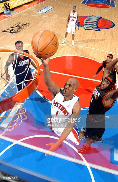 Chauncey Billups of the Detroit Pistons drives against Chris Webber of the Philadelphia 76ers in Game one of the Eastern Conference Quarterfinals...