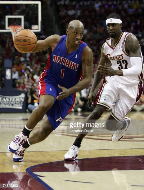 Chauncey Billups of the Detroit Pistons drives against Larry Hughes of the Cleveland Cavaliers in Game Three of the Eastern Conference Finals during...