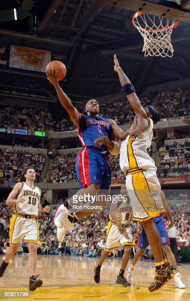 Chauncey Billups of the Detroit Pistons drives into the lane against Jermaine O'Neal of the Indiana Pacers in Game three of the Eastern Conference...
