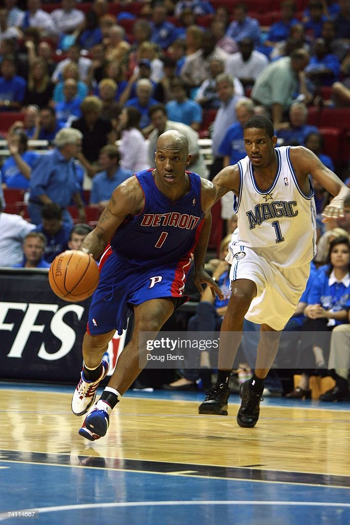 Chauncey Billups #1 of the Detroit Pistons drives to the basket past Trevor Ariza #1 of the Orlando Magic in Game Three of the Eastern Conference Quarterfinals during the 2007 NBA Playoffs at Amway Arena on April 26, 2007 in Orlando, Florida. The Pistons won 93-77.