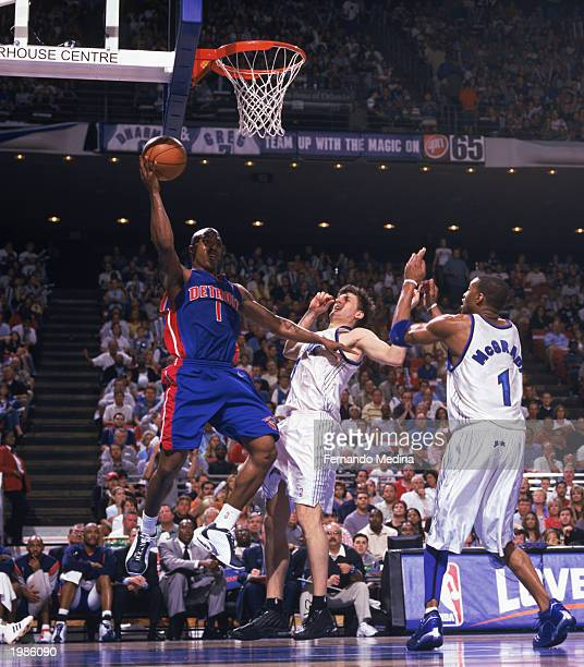 Chauncey Billups of the Detroit Pistons goes to the hoop against Gordan Giricek of the Orlando Magic in Game 6 of the Eastern Conference...
