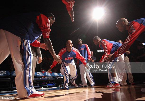 Chauncey Billups of the Detroit Pistons greets his teammates as he enters the court during player introductions prior to Game Two of the Eastern...
