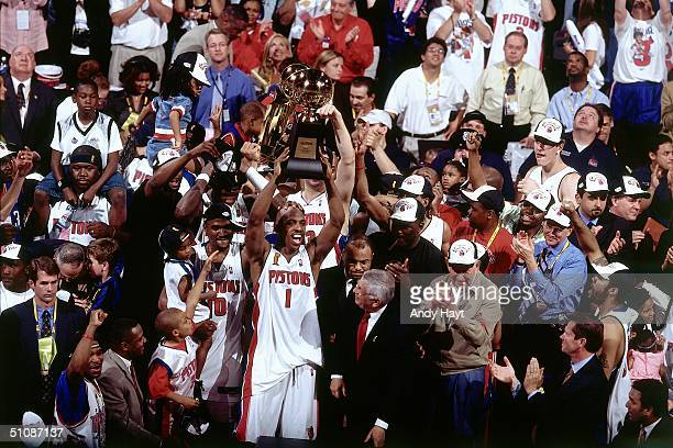 Chauncey Billups of the Detroit Pistons holds his Most Valuable Player Trophy after Game Five of the 2004 NBA Finals on June 15 2004 at The Palace of...
