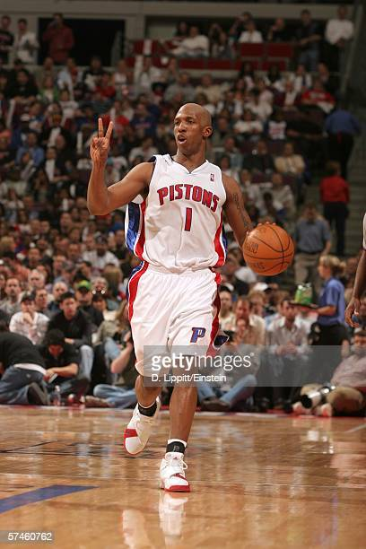Chauncey Billups of the Detroit Pistons holds up two fingers as he goes down court against the Milwaukee Bucks in game two of the Eastern Conference...