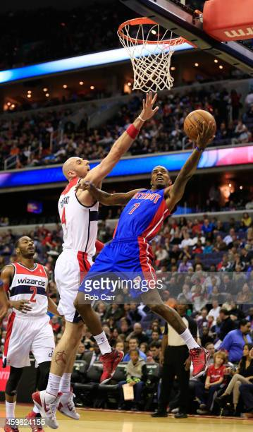 Chauncey Billups of the Detroit Pistons puts up a shot in front of Marcin Gortat of the Washington Wizards during the first half at Verizon Center on...