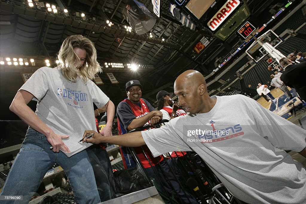 Chauncey Billups #1 of the Detroit Pistons signs a fans t-shirt prior to the Pistons taking on the Indiana Pacers at Conseco Fieldhouse April 3, 2007 in Indianapolis, Indiana.