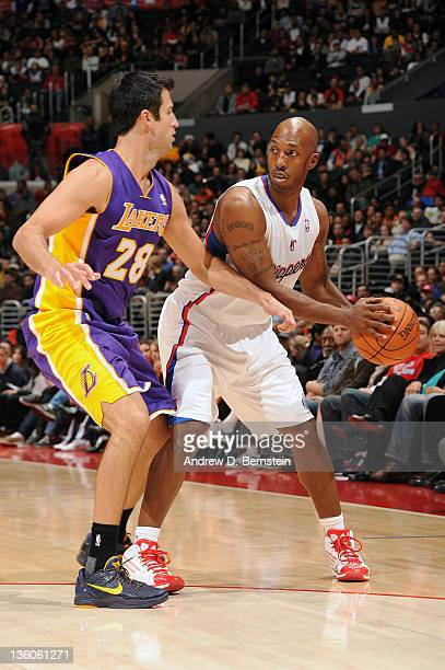 Chauncey Billups of the Los Angeles Clippers looks to make a pass against Jason Kapono of the Los Angeles Lakers at Staples Center on December 21...