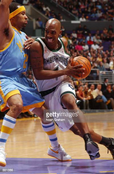 Chauncey Billups of the Minnesota Timberwolves tries to get to the basket past Derek Fisher of the Los Angeles Lakers during the first half of action...