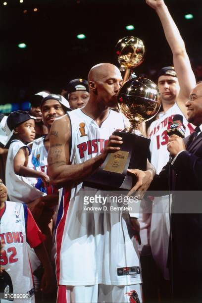 Chauncey Billups#1 of the Detroit Pistons kisses his Most Valuable Player Trophy after Game Five of the 2004 NBA Finals on June 15, 2004 at The...
