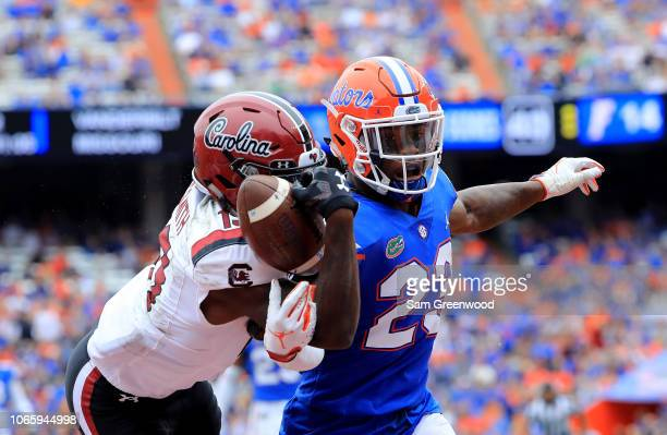 Chauncey GardnerJohnson of the Florida Gators attempts to break up a pass intended for Shi Smith of the South Carolina Gamecocks during the game at...