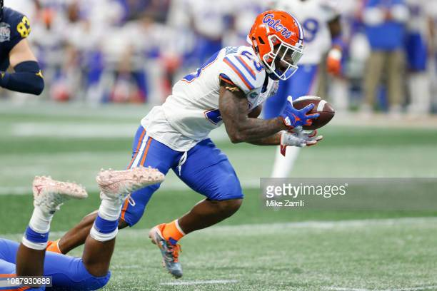 Chauncey Gardner-Johnson of the Florida Gators returns an interception for a touchdown in the fourth quarter against the Michigan Wolverines during...