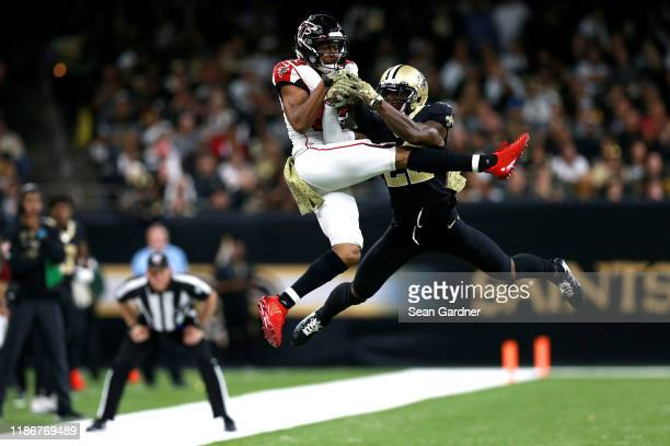 Chauncey GardnerJohnson of the New Orleans Saints breaks up a pass to Russell Gage of the Atlanta Falcons during a NFL game at the Mercedes Benz...