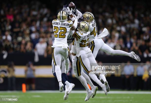 Chauncey GardnerJohnson of the New Orleans Saints Marcus Williams and Marshon Lattimore breaks up a pass intended for Amari Cooper of the Dallas...