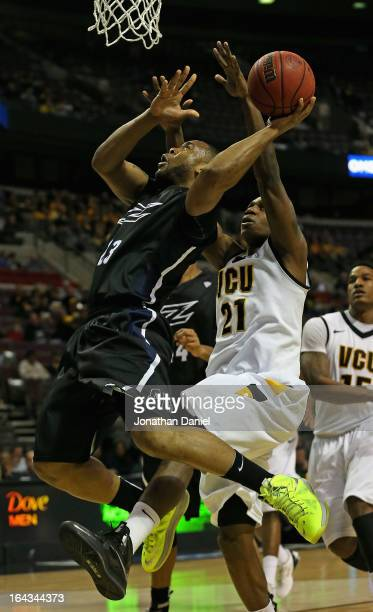 Chauncey Gilliam of the Akron Zips shoots against Treveon Graham of the VCU Rams during the second round of the 2013 NCAA Men's Basketball Tournament...