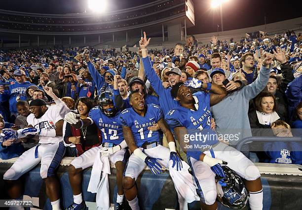 Chauncey Lanier, Brayden Scott and Latarius Brady of the Memphis Tigers celebrate winning the AAC after a game against the Connecticut Huskies on...