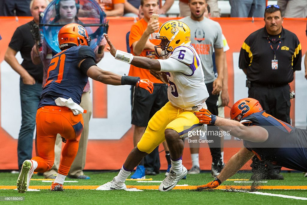 Chauncey Scissum #21 of the Syracuse Orange stops Brandon Harris #6 of the LSU Tigers on a quarterback scramble on September 26, 2015 at The Carrier Dome in Syracuse, New York. LSU defeats Syracuse 34-24.