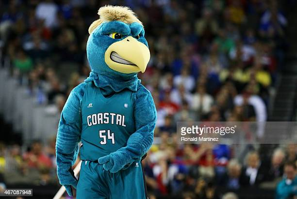 Chauncey the Chanticleer the Coastal Carolina Chanticleers mascot performs in the first half against the Wisconsin Badgers during the second round of...