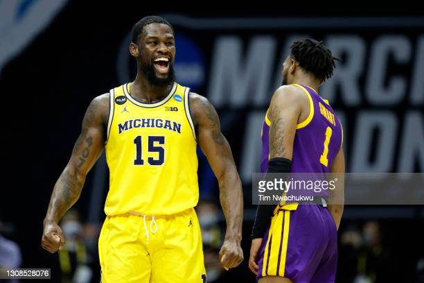 Chaundee Brown of the Michigan Wolverines reacts to beating the LSU Tigers in the second round game of the 2021 NCAA Men's Basketball Tournament at...