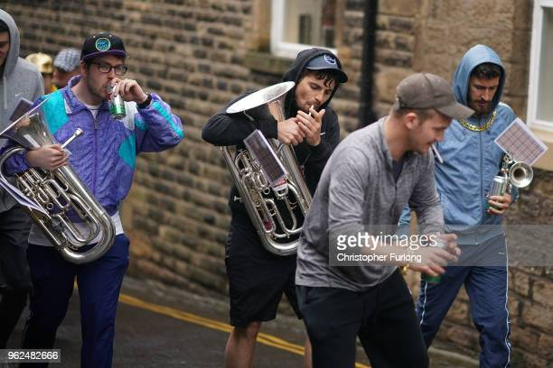 Chav Brass Band members take a beak as they compete in the Whit Friday brass band competition in the village of Dobcross on May 25 2018 in Oldham...