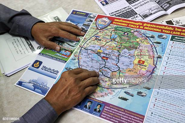 Chavalit Ongkavanit advisor to the Ubon Chamber of Commerce looks at a map displaying the 'Economic Circle in Indochina' project during an interview...