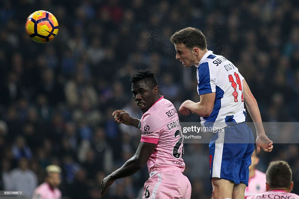 Chaves Carlos Ponck jumps with Porto's Portuguese midfielder Diogo Jota during the Premier League 2016/17 match between FC Porto and GD Chaves, at Dragao Stadium in Porto on December 19, 2016.