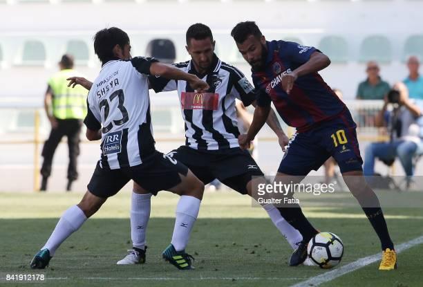 GD Chaves forward Perdigao from Brazil with Portimonense SC defender Ricardo Fernandes from Portugal Portimonense SC forward Shoya Nakajima from...