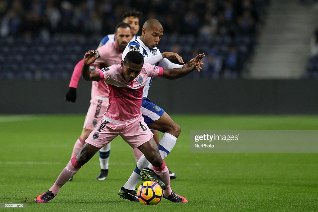 Chaves players Assis with Porto's Algerian forward Yacine Brahimi during the Premier League 2016/17 match between FC Porto and GD Chaves, at Dragao Stadium in Porto on December 19, 2016.