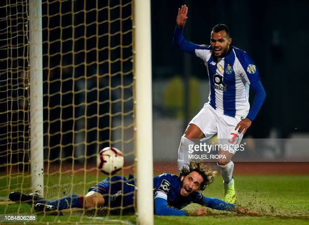 Chaves' Portuguese defender Nuno Andre Coelho reacts as Porto's Brazilian forward Fernando Andrade scores a goal during the Portuguese League...