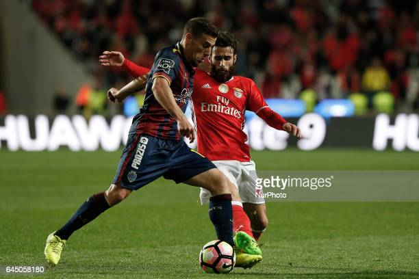 Chaves's forward Pedro Tiba vies for the ball with Benfica's midfielder Rafa Silva during Premier League 2016/17 match between SL Benfica vs GD...