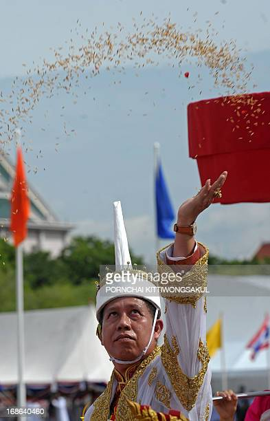 Chawalit Chukhachorn, lord of the Royal Ploughing Ceremony, throws rice seeds during the event at Sanam Luang in Bangkok on May 13, 2013. The annual...