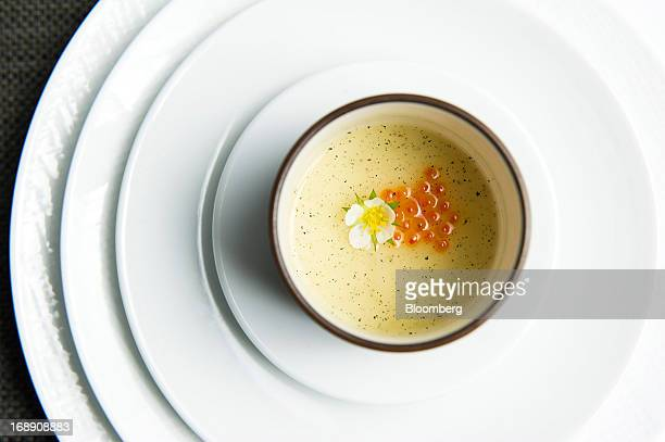 Chawanmushi, egg custard steamed in a tea cup, is served at Corton restaurant in New York, U.S., on Friday, May 10, 2013. Corton opened less than a...