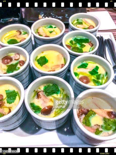 'chawanmushi' japanese traditional egg custard served as party food at year-end dinner party of a company - chawanmushi stock pictures, royalty-free photos & images