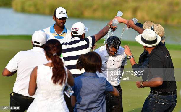 Chawrasia of India is showered in water by friends on the 18th hole during the final round of the Hero Indian Open at Dlf Golf and Country Club on...