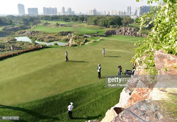 Chawrasia of India plays a chip shot on the 17th hole during the continuation of the delayed third round the Hero Indian Open at Dlf Golf and Country...