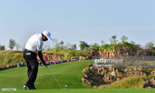 Chawrasia of India plays his approach shot on the 17th hole during the final round of the Hero Indian Open at Dlf Golf and Country Club on March 12,...