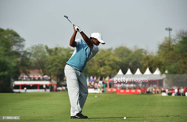 Chawrasia of India plays his approach shot on the 18th hole during the final round of the Hero Indian Open at Delhi Golf Club on March 20, 2016 in...